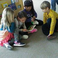 Children gather in the reading area for an interesting story!